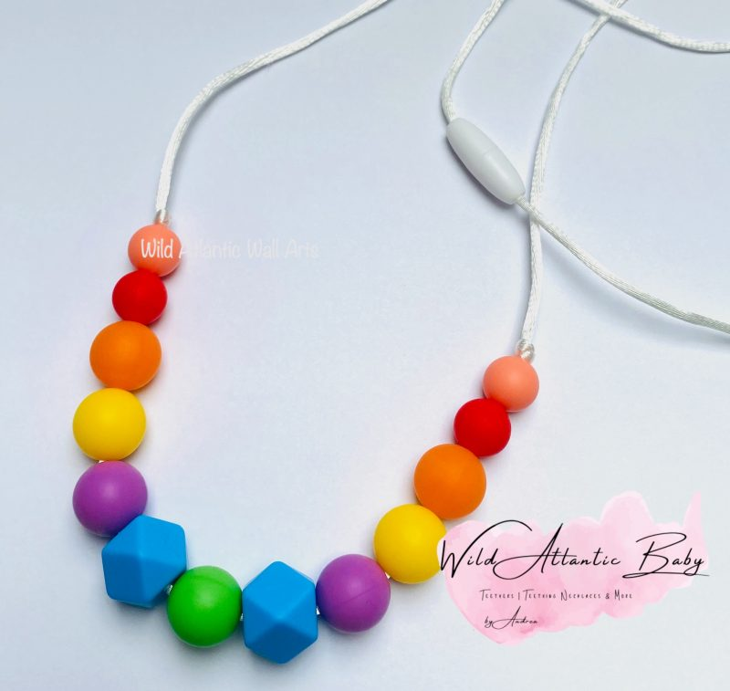 Rainbow Silicon Necklace, Teething, Nursing, Feeding, Breastfeeding toy, Is your baby like to grab on things while they are being carried? Or grasp during nursing? The Silicone Teething Necklace is designed to be worn by moms keeping babies hands busy, helping to stimulate senses and soothe sore gums. BPA free silicon teether